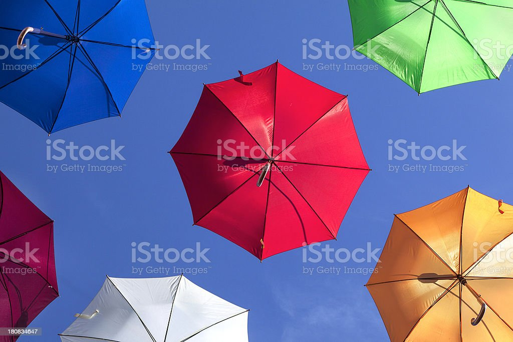 Flying umbrellas stock photo