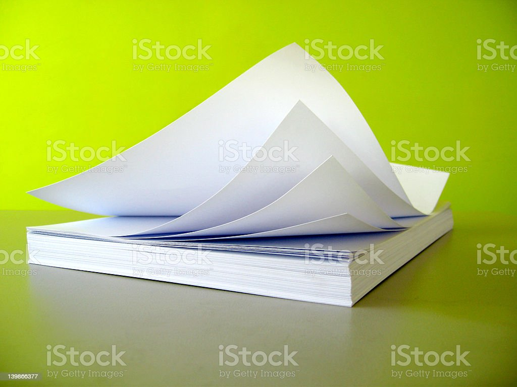 flying white papers stock photo