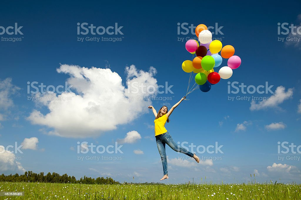 Flying with balloons royalty-free stock photo