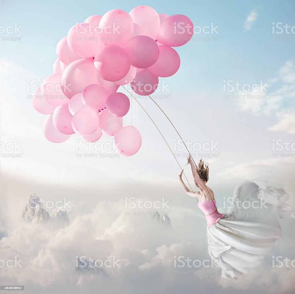 Flying with balloons stock photo