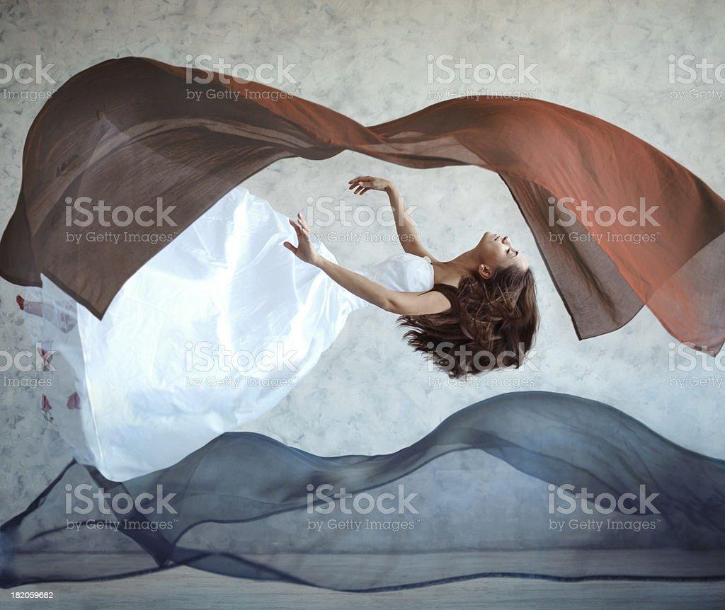 Flying woman stock photo