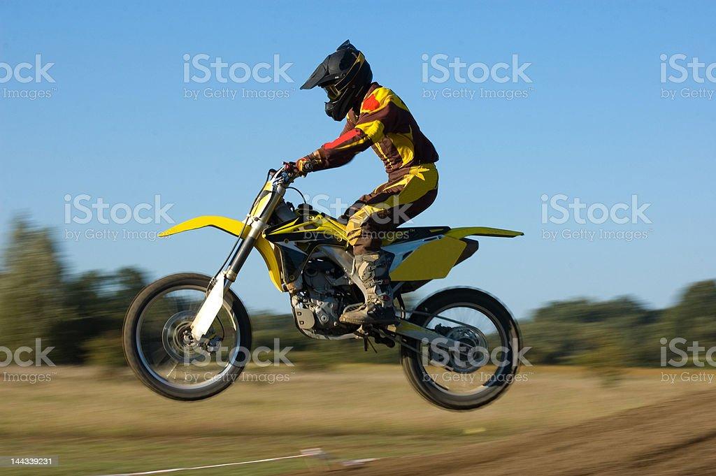 Flying yellow motocross stock photo