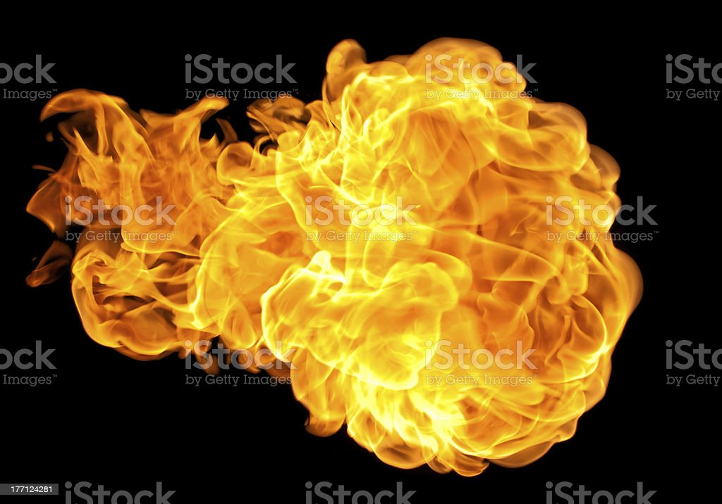 Flying yellowish orange fireball stock photo