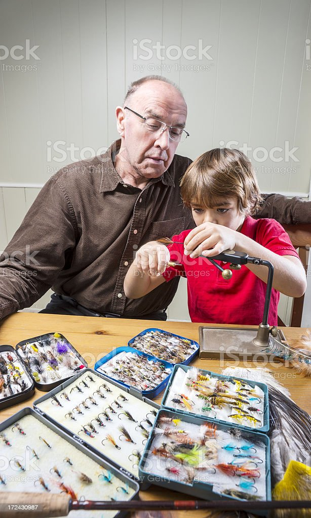 Fly-tying with granddad. stock photo