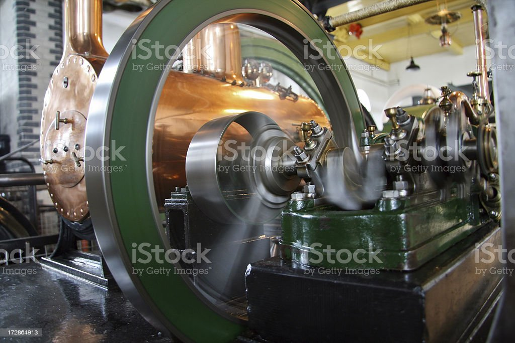 flywheel of operating steam engine royalty-free stock photo