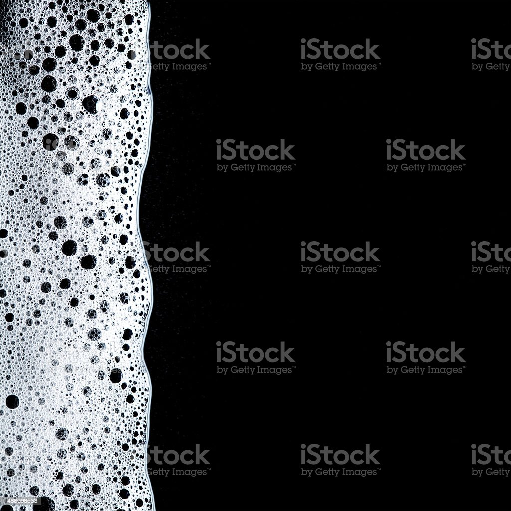 Foam bubbles abstract dark background stock photo