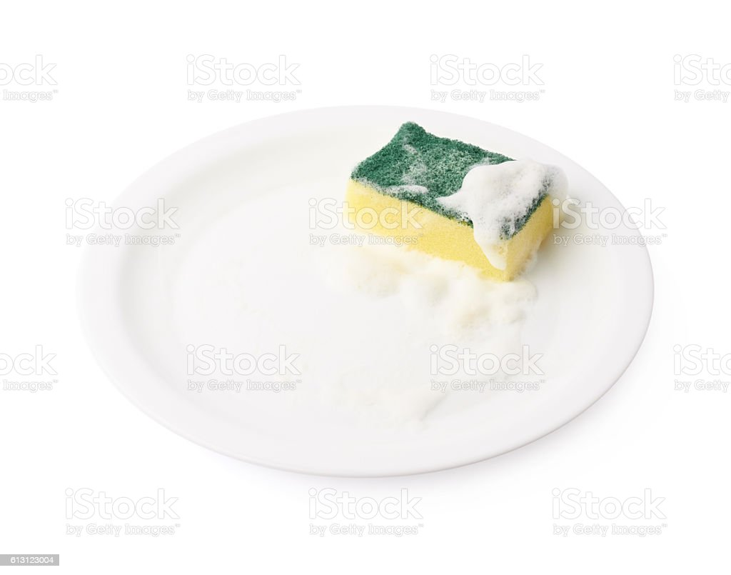 Foam covered sponge over ceramic plate stock photo