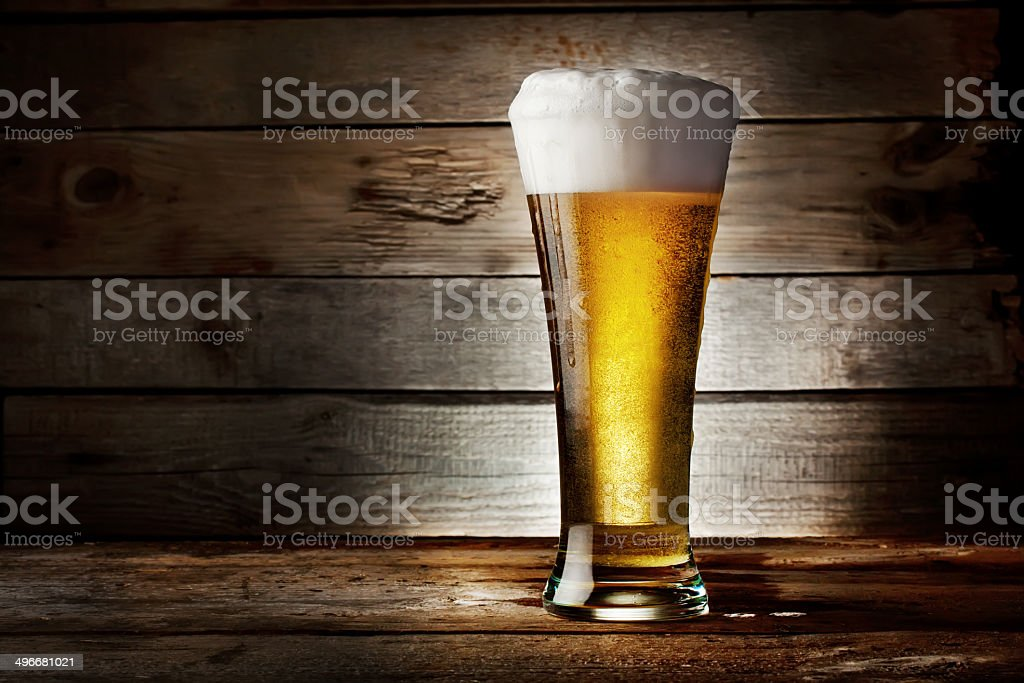 Foam glass of lager beer stock photo