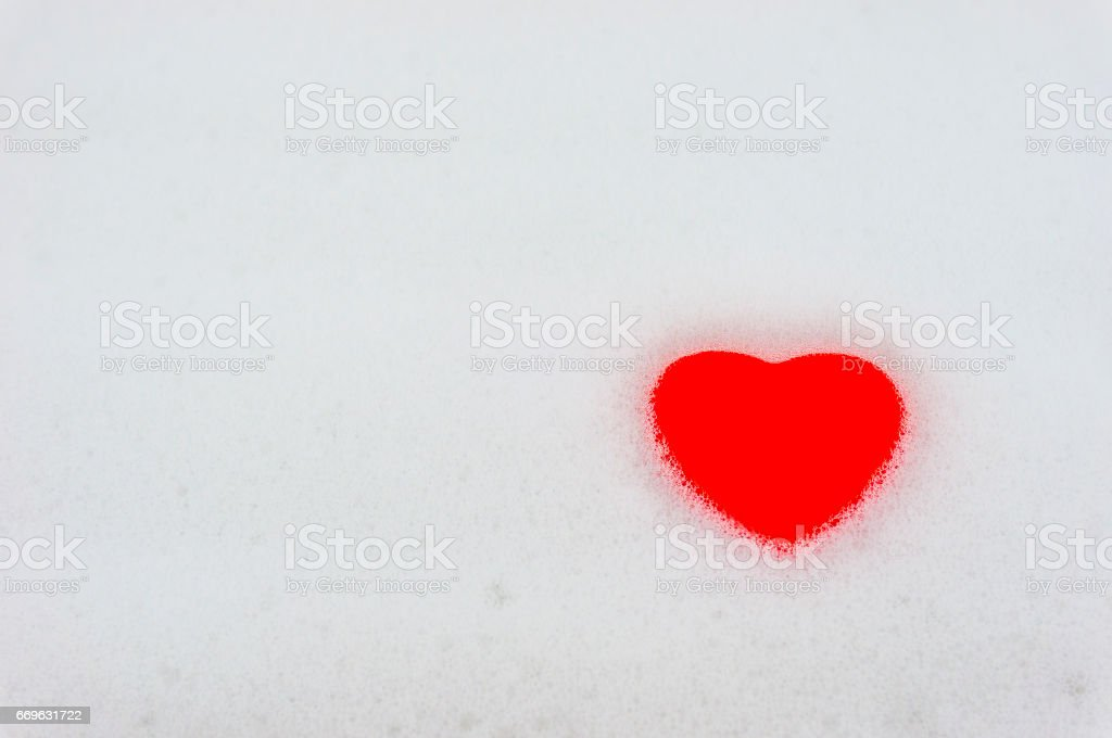 Foam in the bathroom with a heart. stock photo