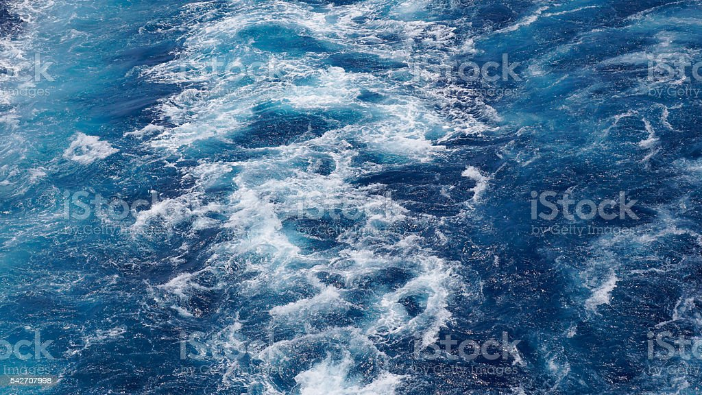 foam on the blue sea stock photo