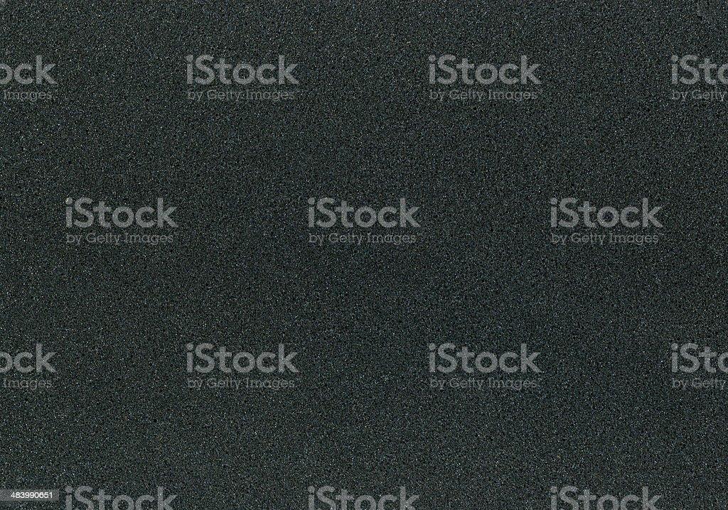 Foamed black plastic stock photo