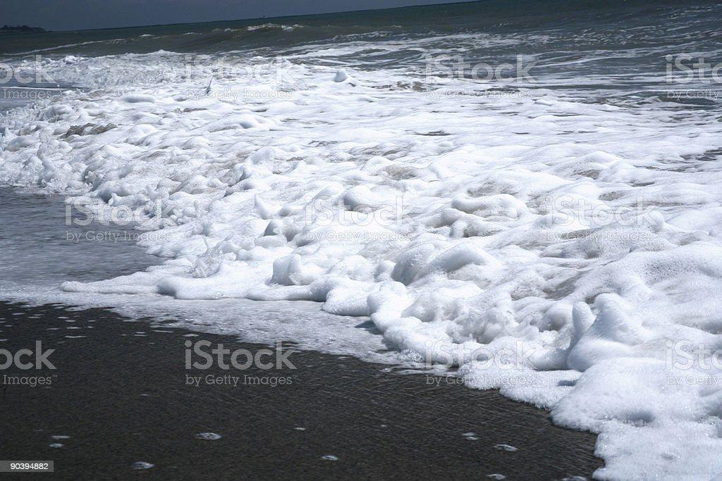 foamy beach stock photo