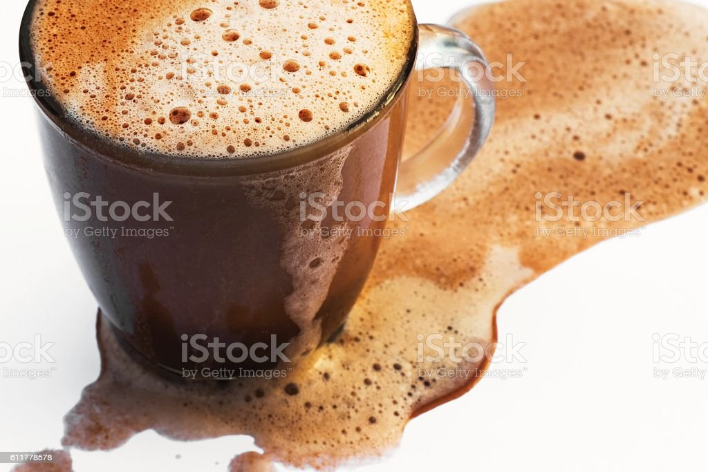 Foamy beverage flows out stock photo