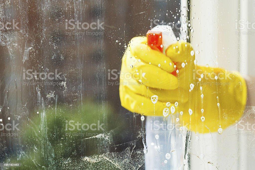 foamy liquid on window glass during washing stock photo