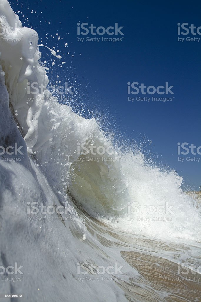 Foamy wave on a clear blue day royalty-free stock photo