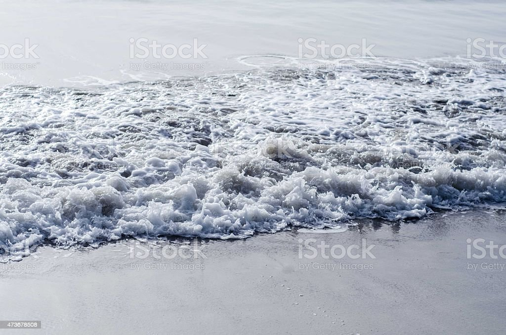 foamy waves nature background stock photo
