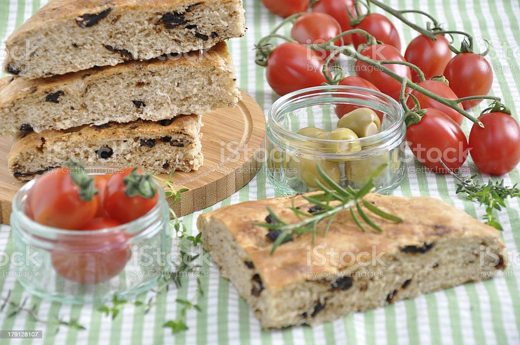 Focaccia Bread with tomatoes and herbs royalty-free stock photo