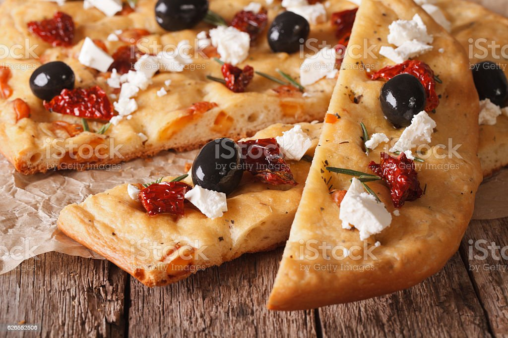 Focaccia with dried tomatoes, feta and olives. macro horizontal stock photo