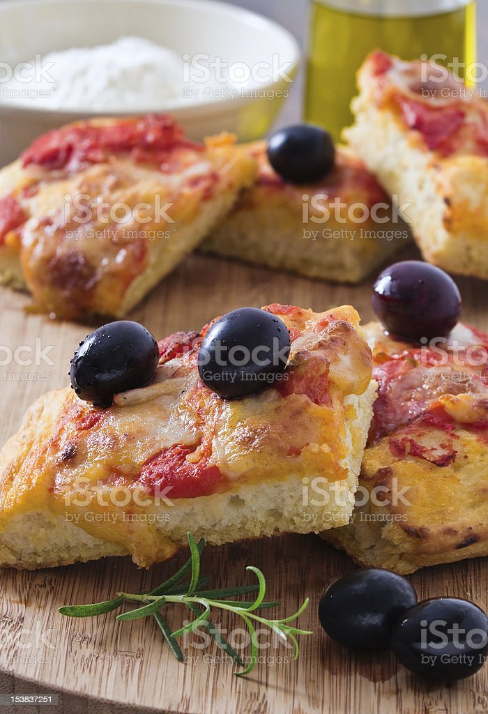 Focaccia with tomato and black olives. royalty-free stock photo