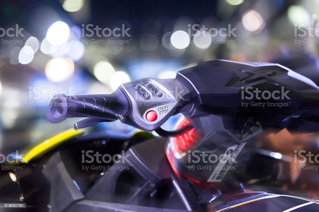 Focus of electric switch on control handle of bike stock photo