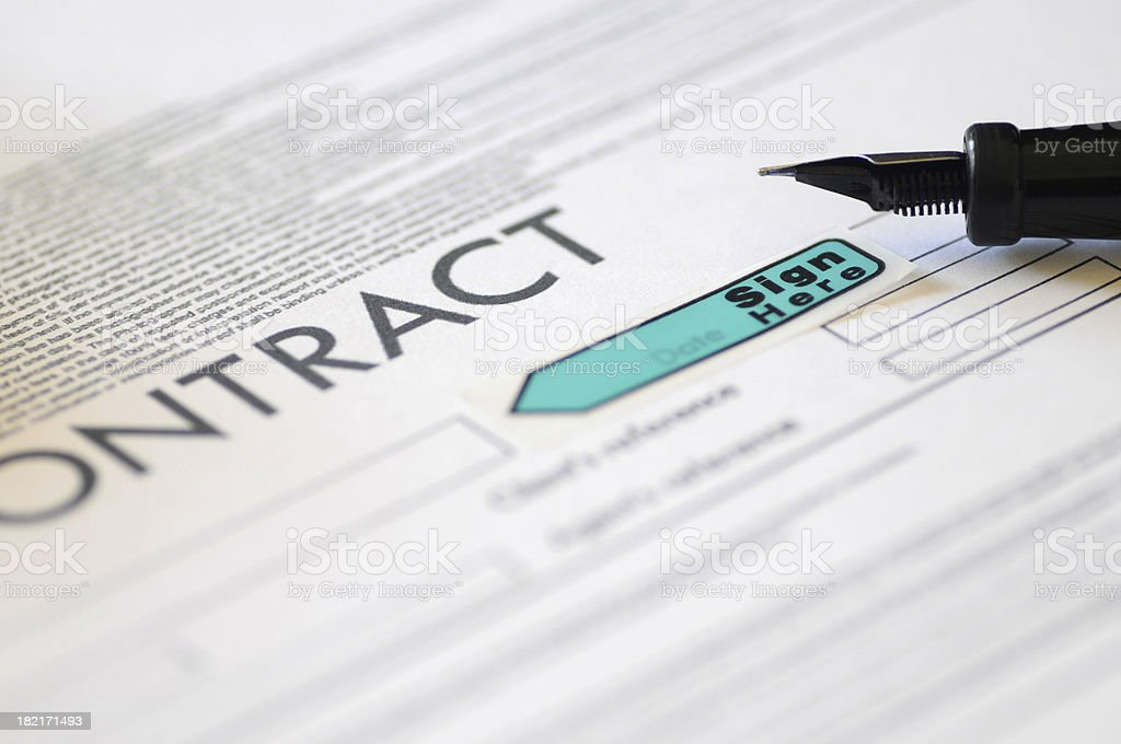 Focus of tip of fountain pen resting on a contract stock photo
