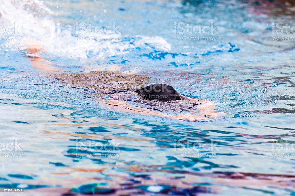 Focus of woman swimmer in swimming pool stock photo