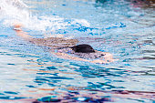 Focus of woman swimmer in swimming pool