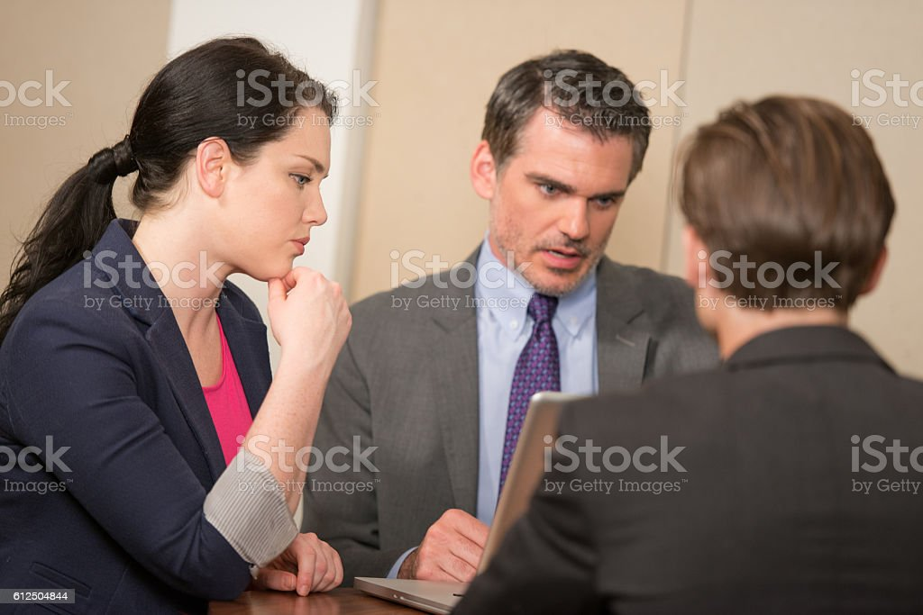 Focus on Businesswoman Working with Male Collegues stock photo