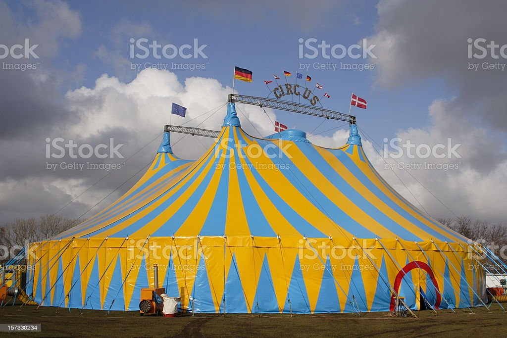 Focus on Circus tent with dramatic cloudscape background stock photo