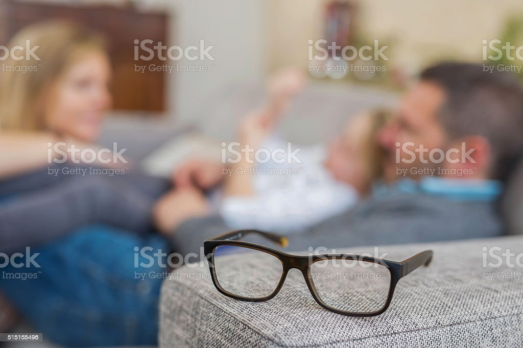 focus on eyeglasses, at home stock photo