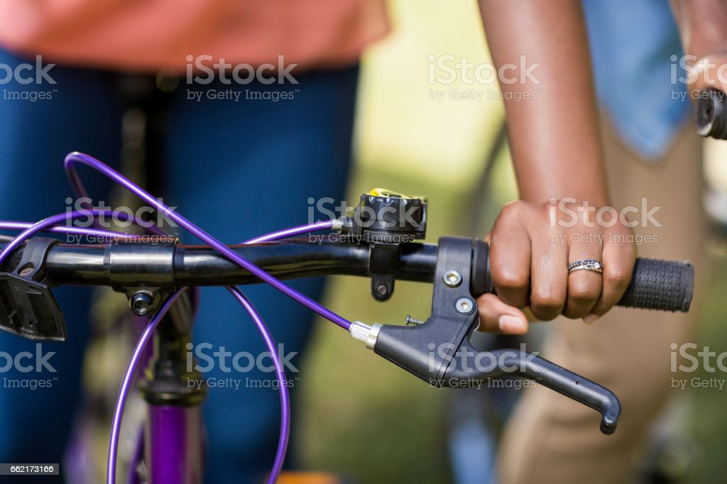 focus on hands and bicycle stock photo