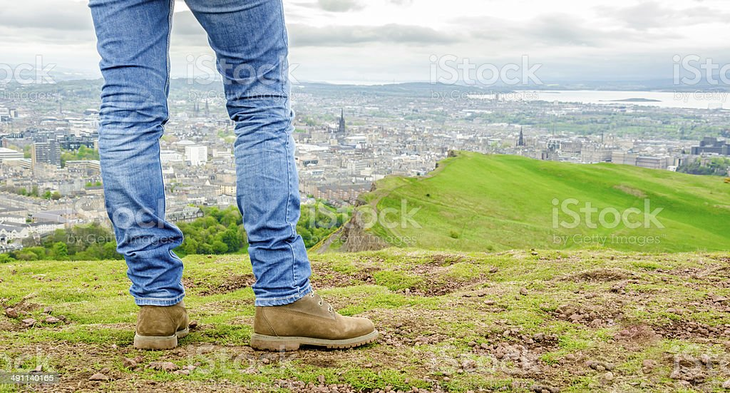 Focus on legs of a female model wearing skinny jeans stock photo