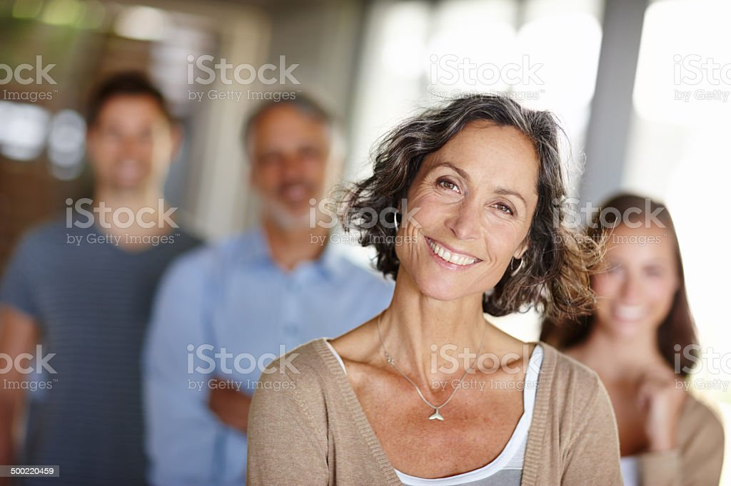 Focus on mother with blurred family in background stock photo