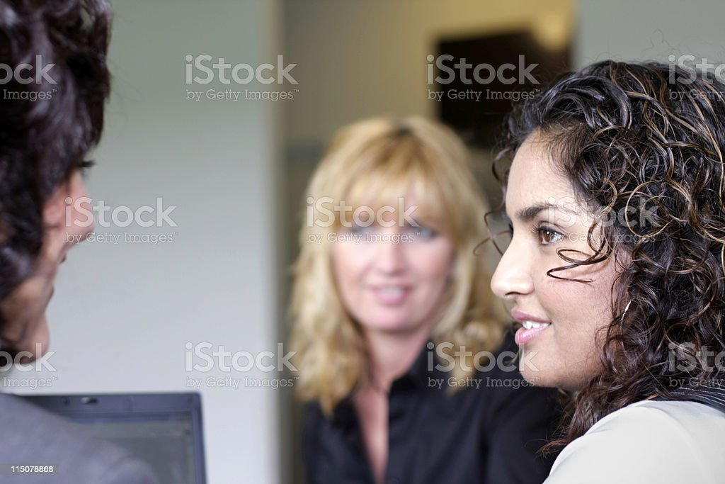 Focus on one business woman in group of three royalty-free stock photo