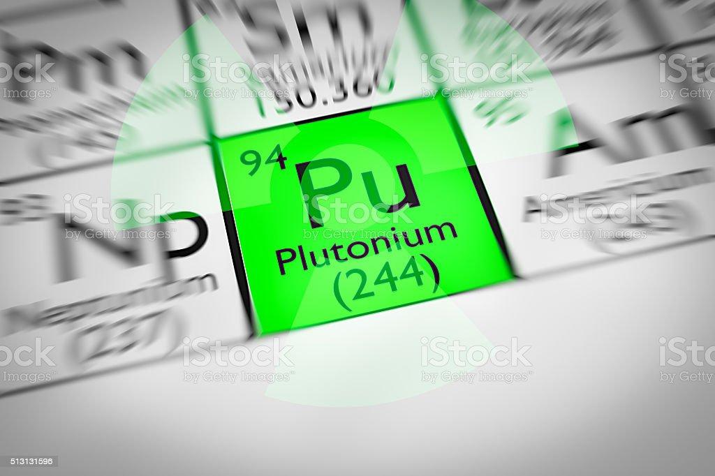 Focus on radioactive green Plutonium Chemical Element stock photo