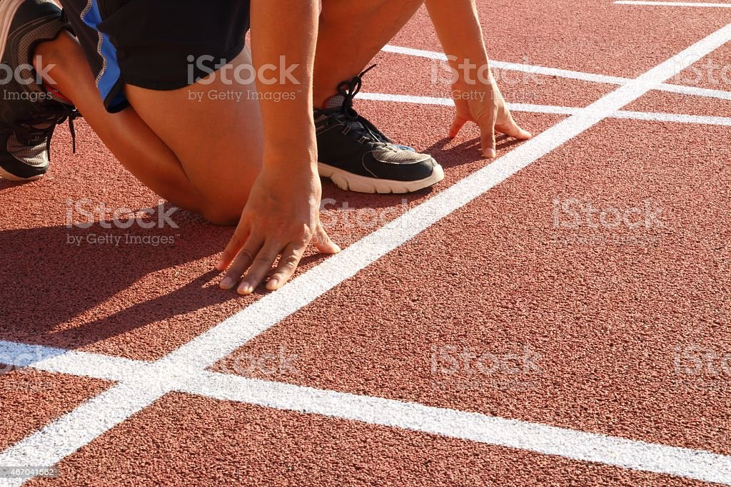 Focus on runner start points, at which point release. stock photo
