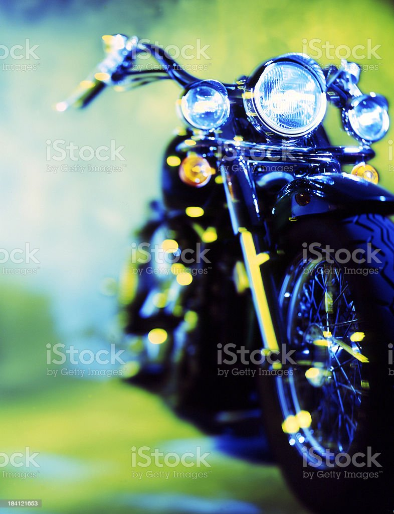 Focus on the front of a black and yellow motorcycle outside royalty-free stock photo