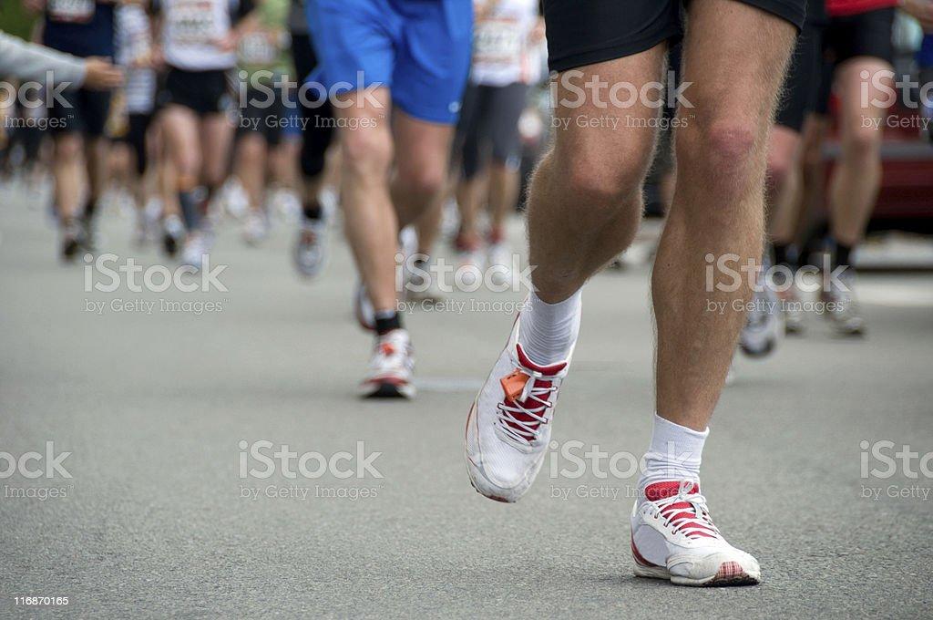 Focus on the legs of several marathon runners stock photo