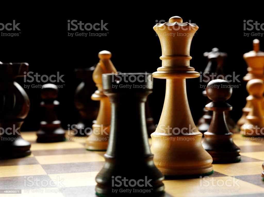 Focus on the Queen Chess Piece in a Board Game stock photo
