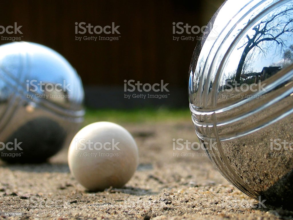 Focus on two metal boules and small wooden ball stock photo