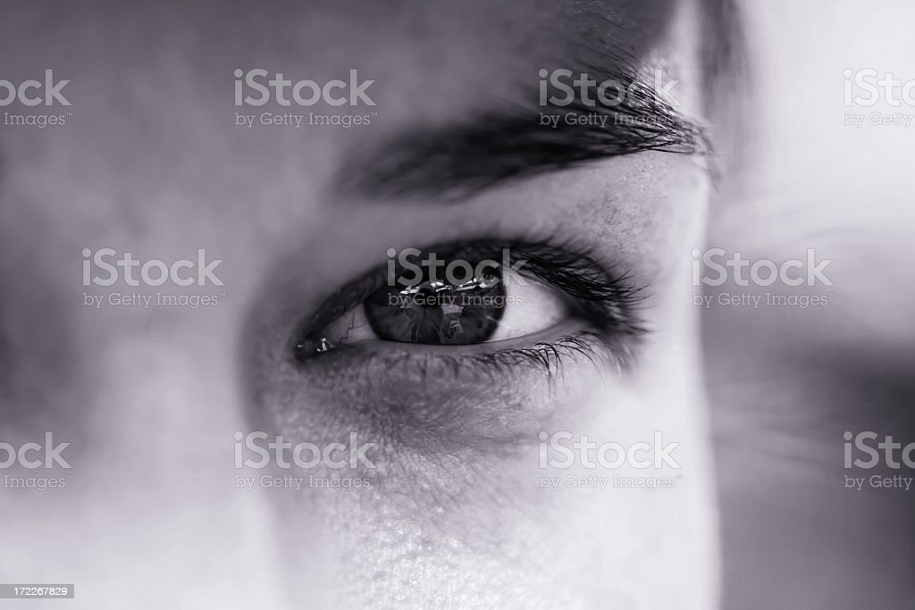 A focus shot of an eye of a man in black and white  royalty-free stock photo