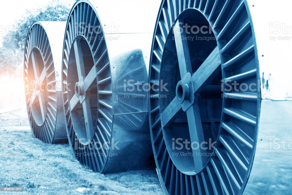 Focus so desiredSteel roller with fiber optic cables for the installation of data cables on a construction site. stock photo