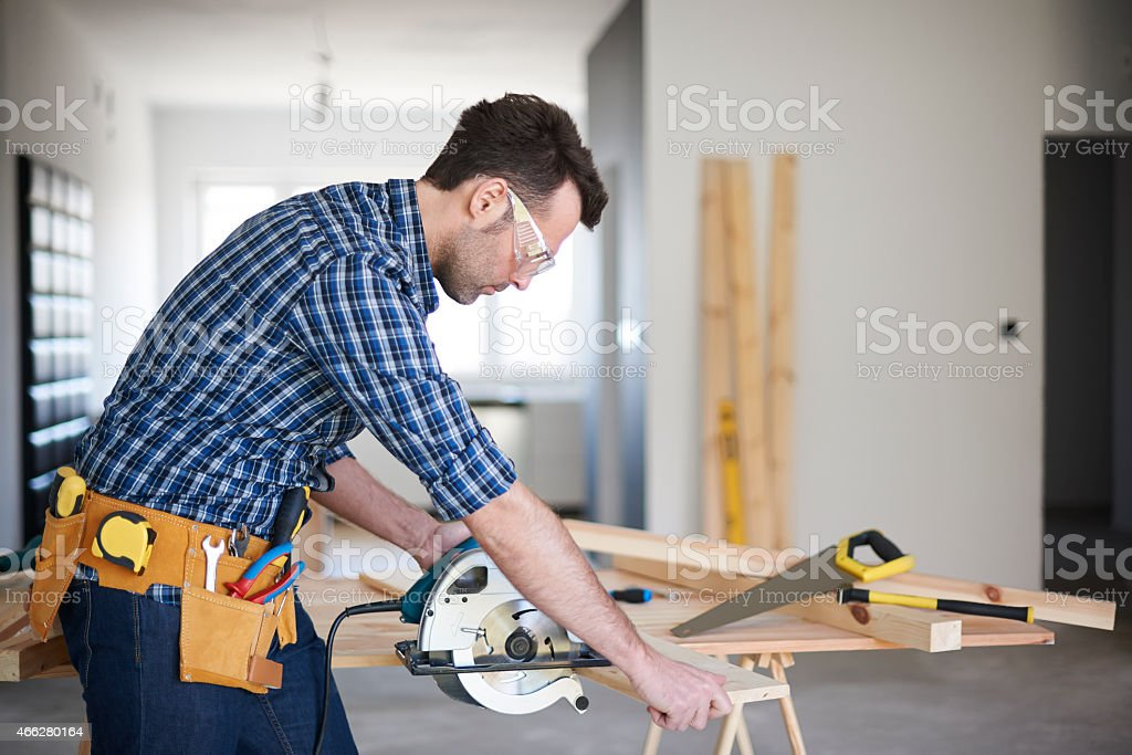 Focus when you use the electric saw stock photo