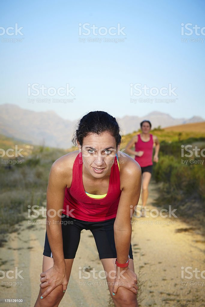 Focused athlete waiting for friend stock photo