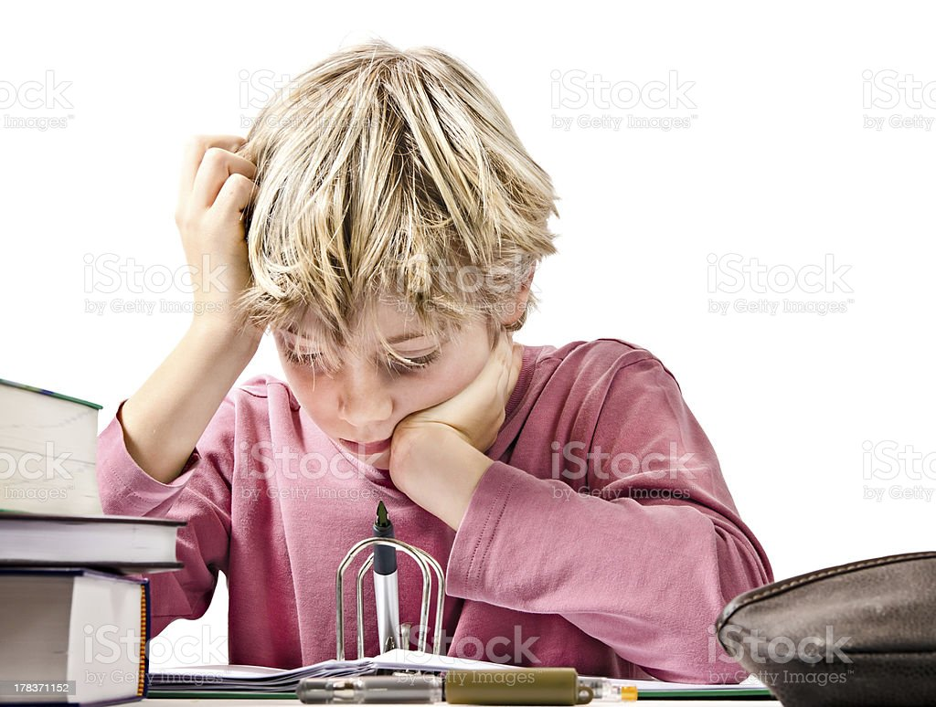 focused boy doing his homework royalty-free stock photo