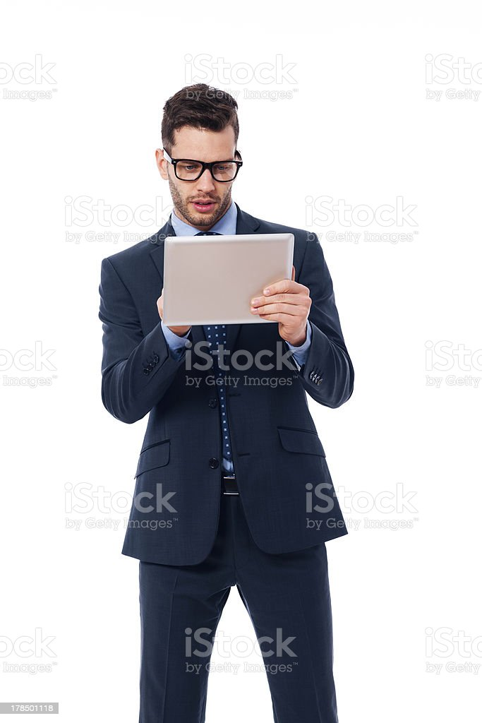 Focused businessman using a digital tablet royalty-free stock photo