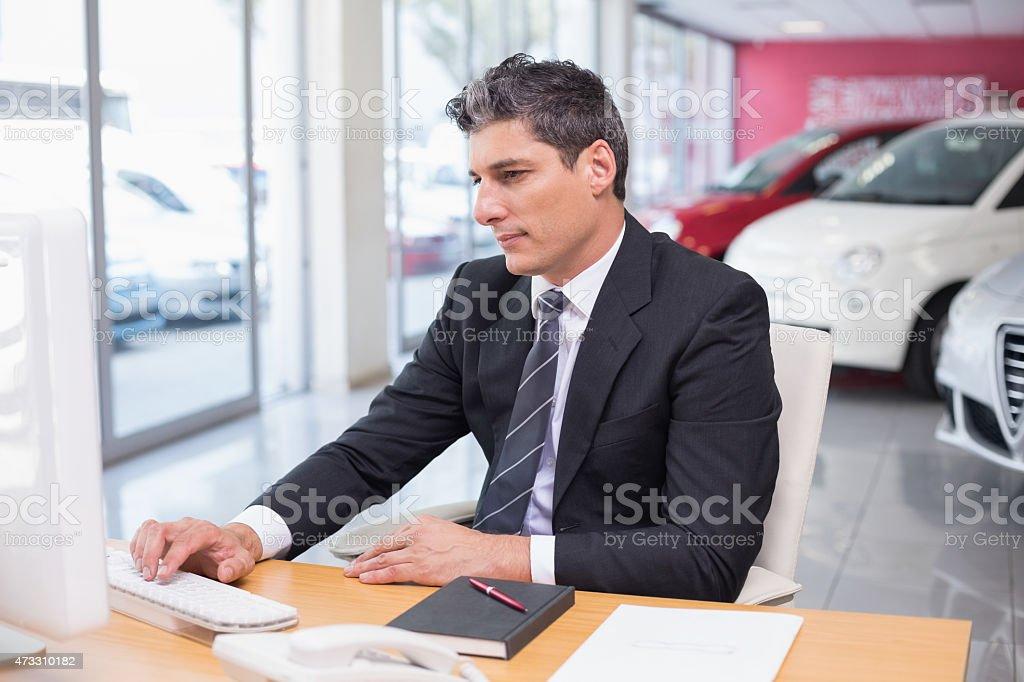Focused businessman using his laptop stock photo