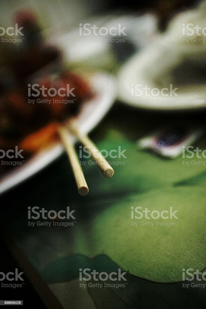 Focused Chopsticks at a Chinese Restaurant royalty-free stock photo