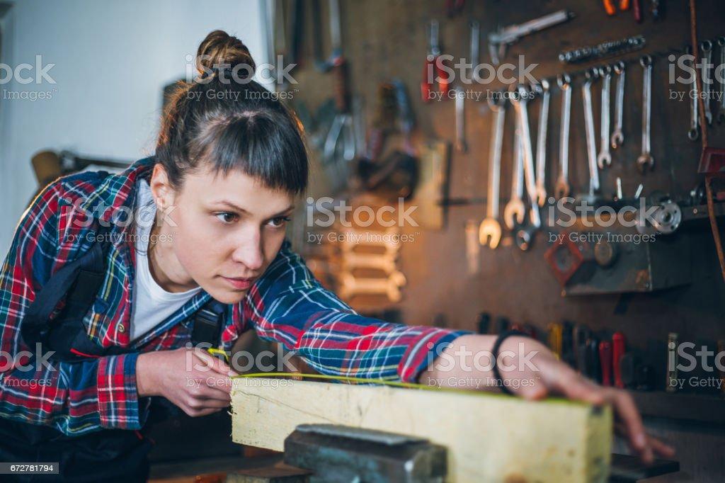 Focused Female Carpenter stock photo