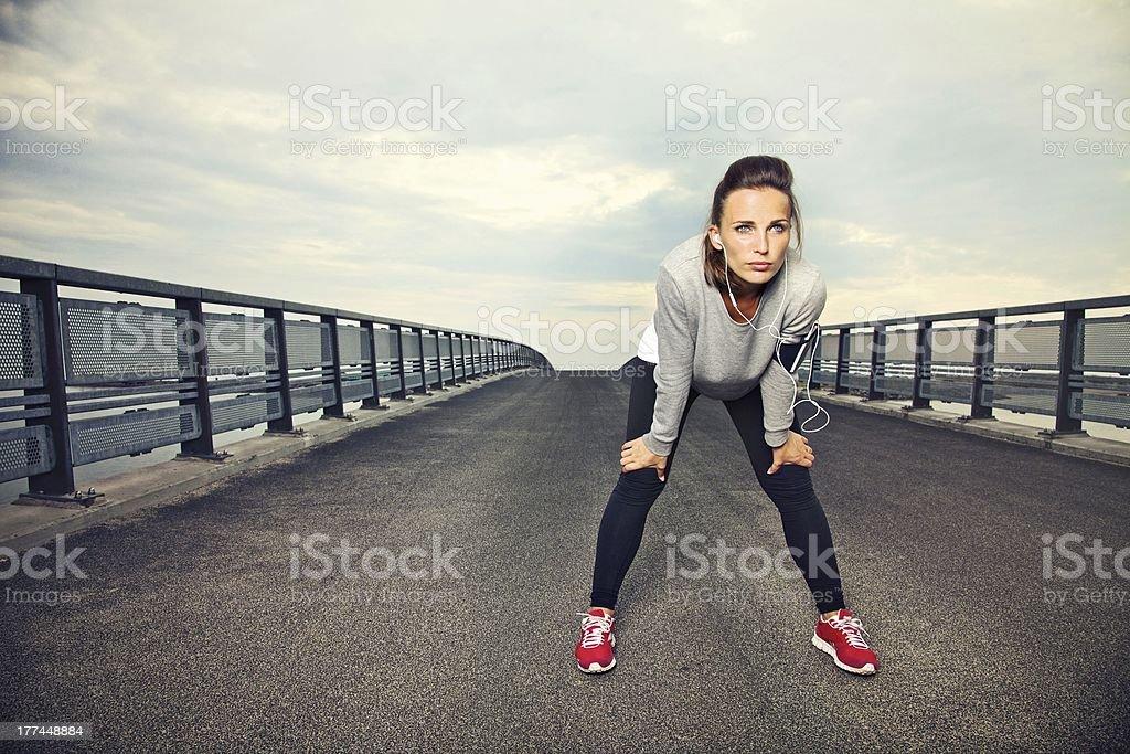 Focused Female Runner Resting royalty-free stock photo